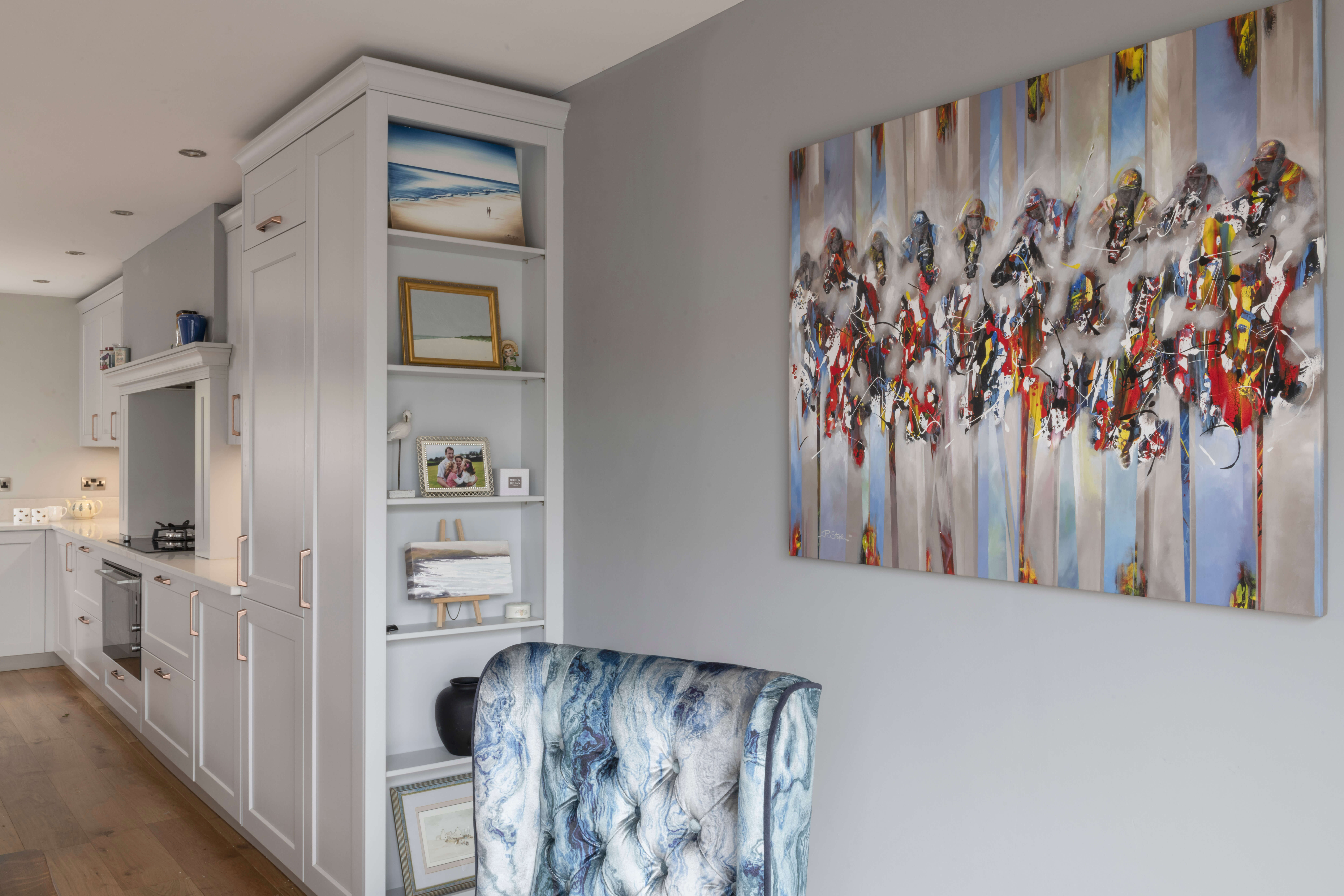 A light and airy dining area is complemented by the clients' artwork