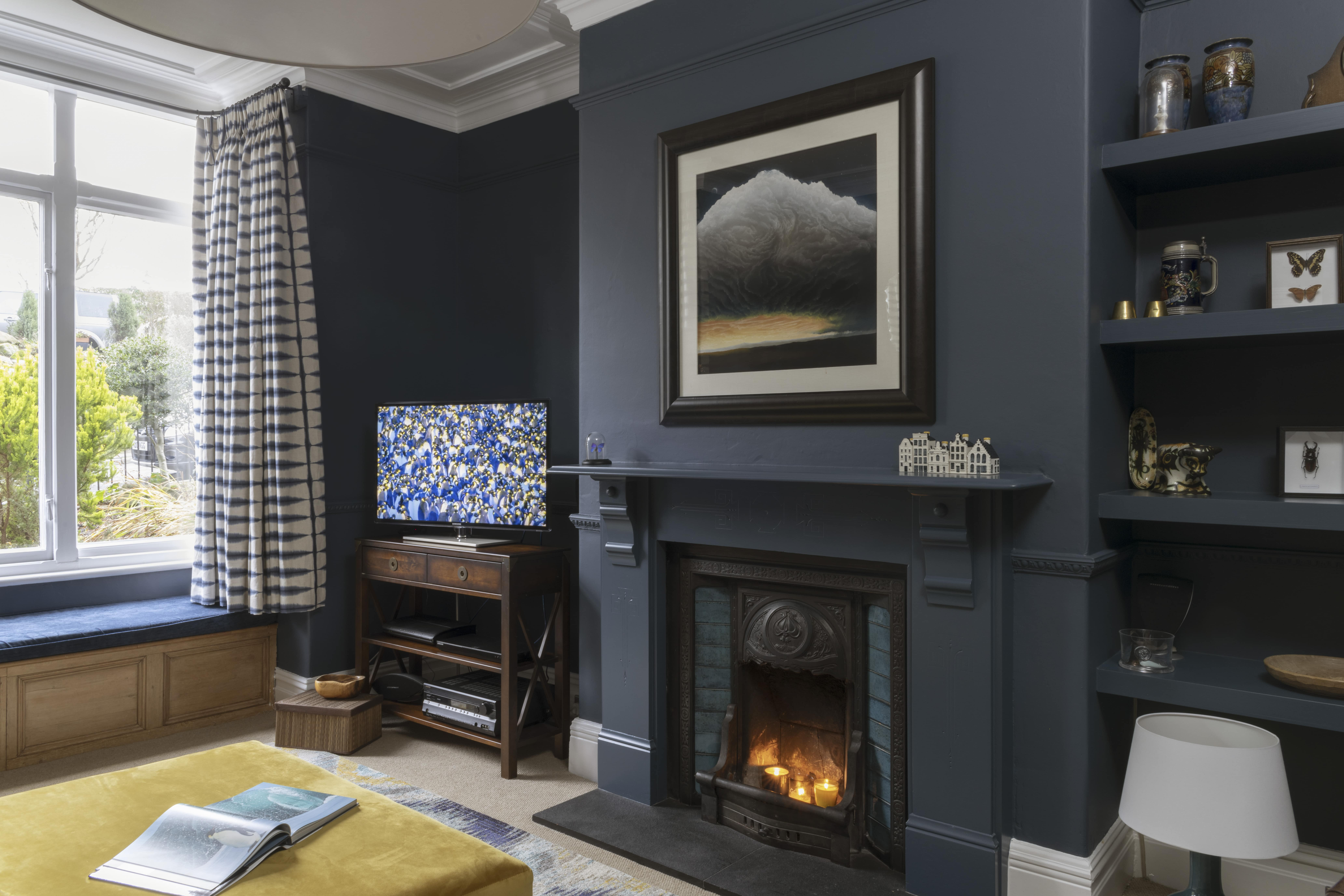 Rich navy walls made this sitting room a cosy place to retreat to