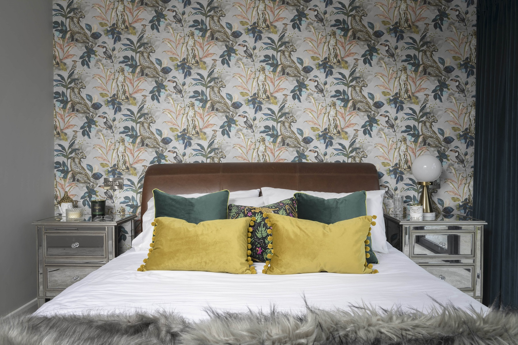 Bedroom with cheetash wallpaper and rich greens