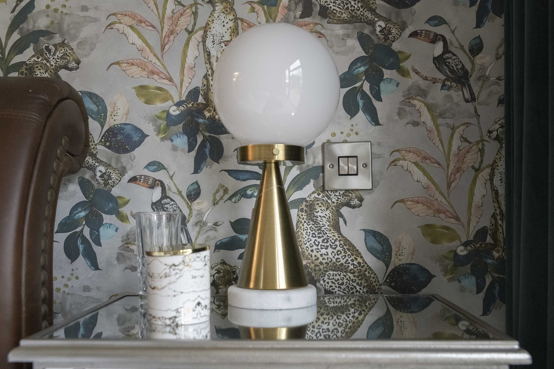 Bedside detail with brass and marble lamp, Yorkshire