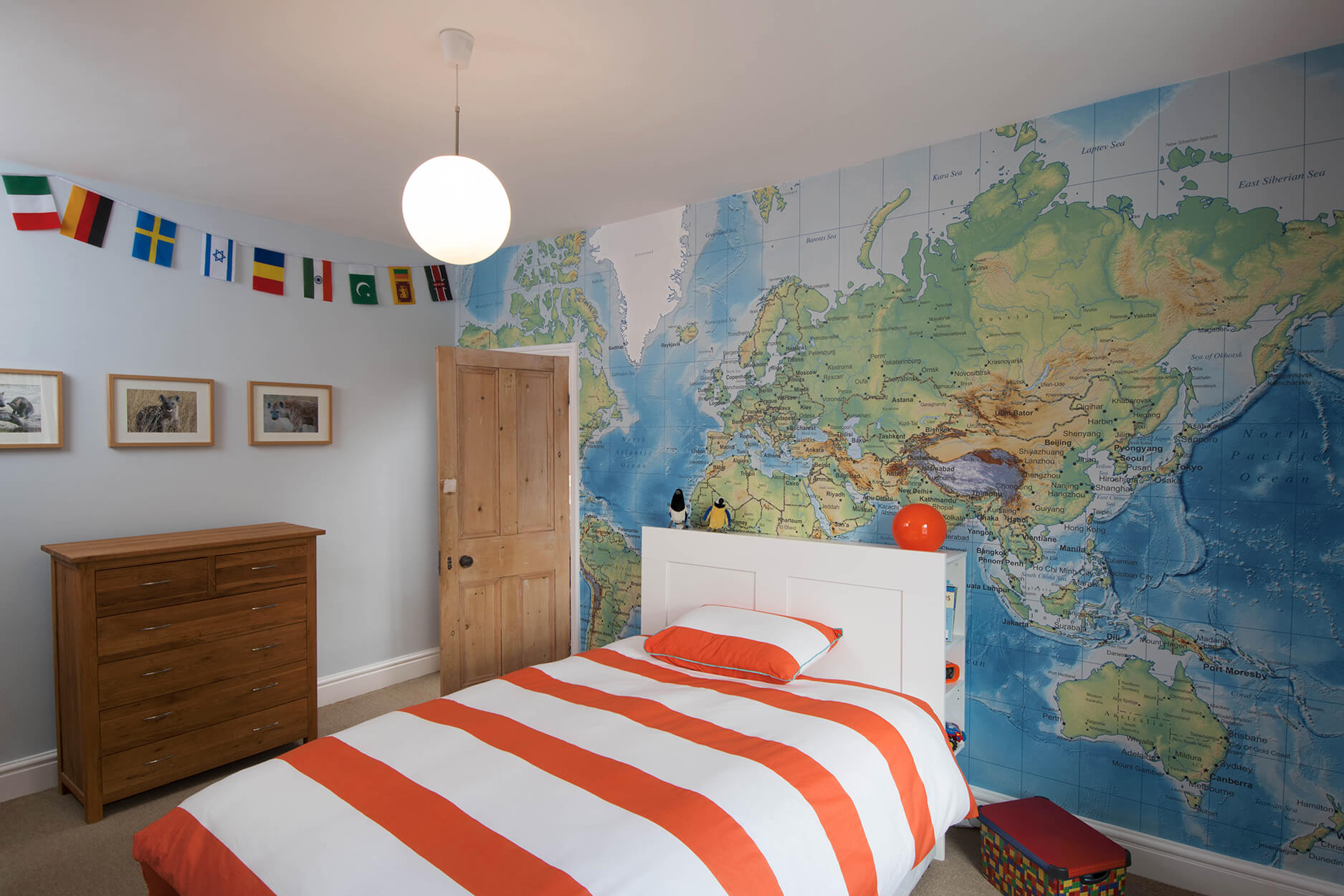 A map mural is a brilliant way to track family trips for this small boy