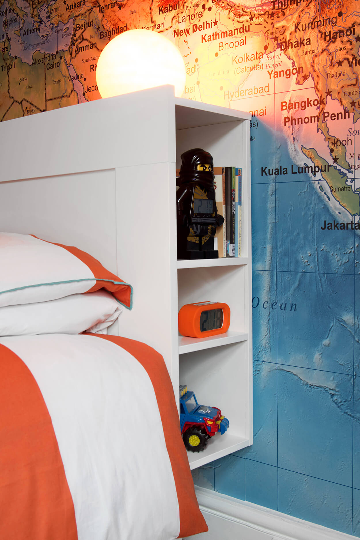 Lots of storage in this little boy's room mean is favourite treasures are to hand at bedtime