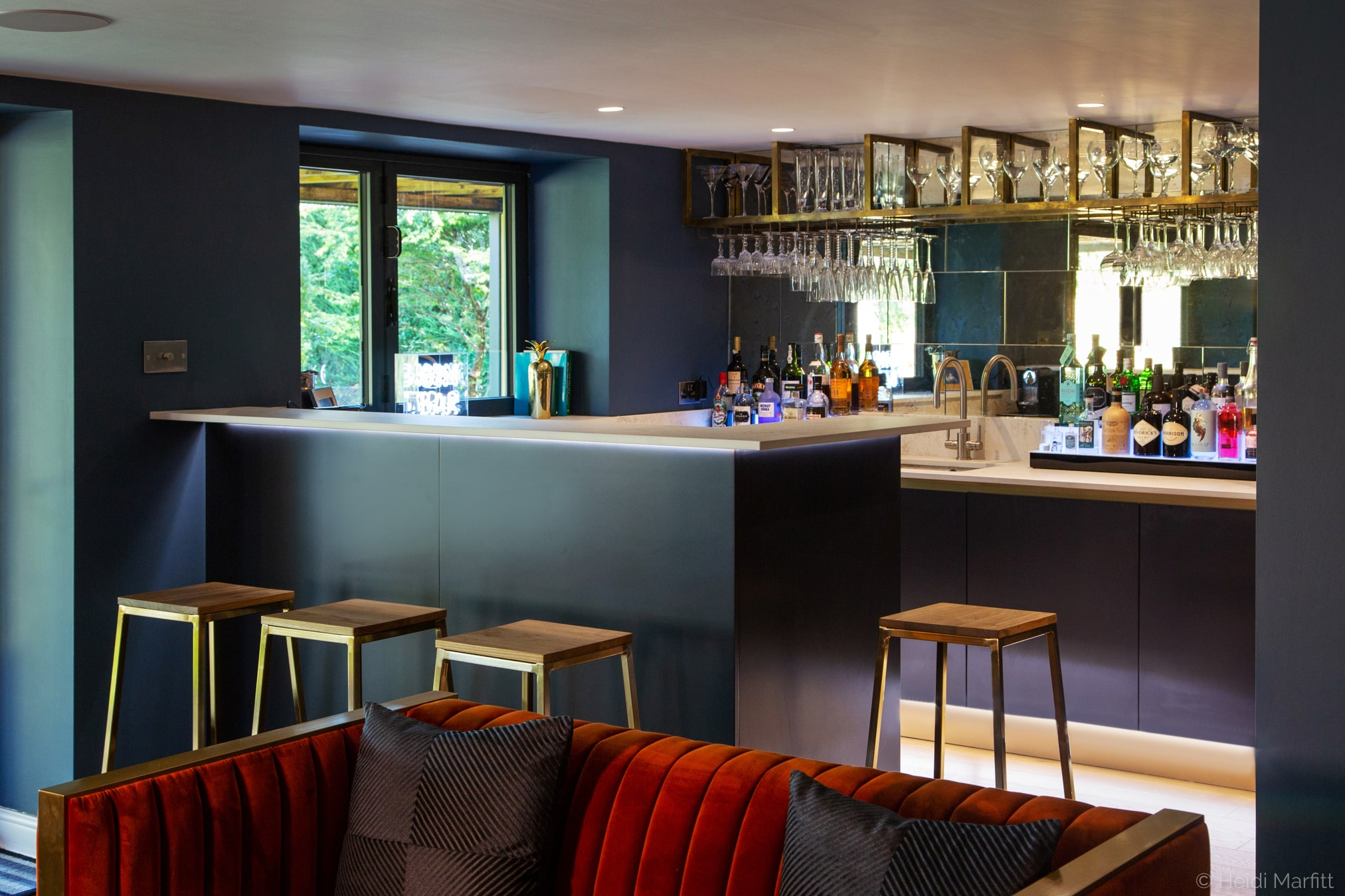 A bespoke bar means this basement is the perfect place to celebrate in style