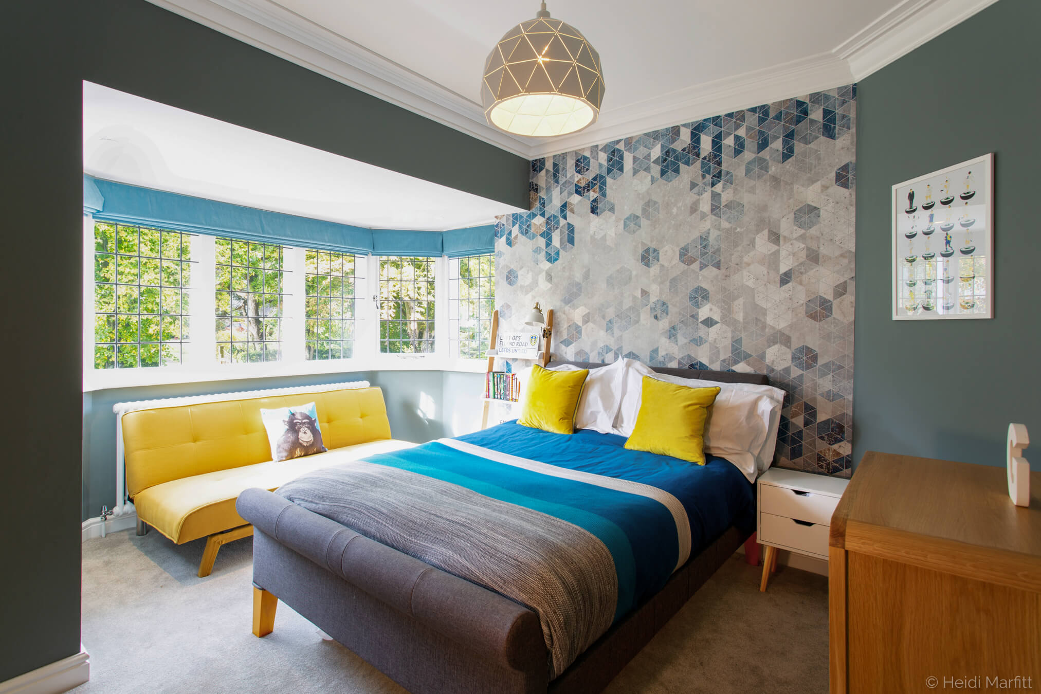 Geometric wallpaper brings a sophisticated vibe to this boy's bedroom