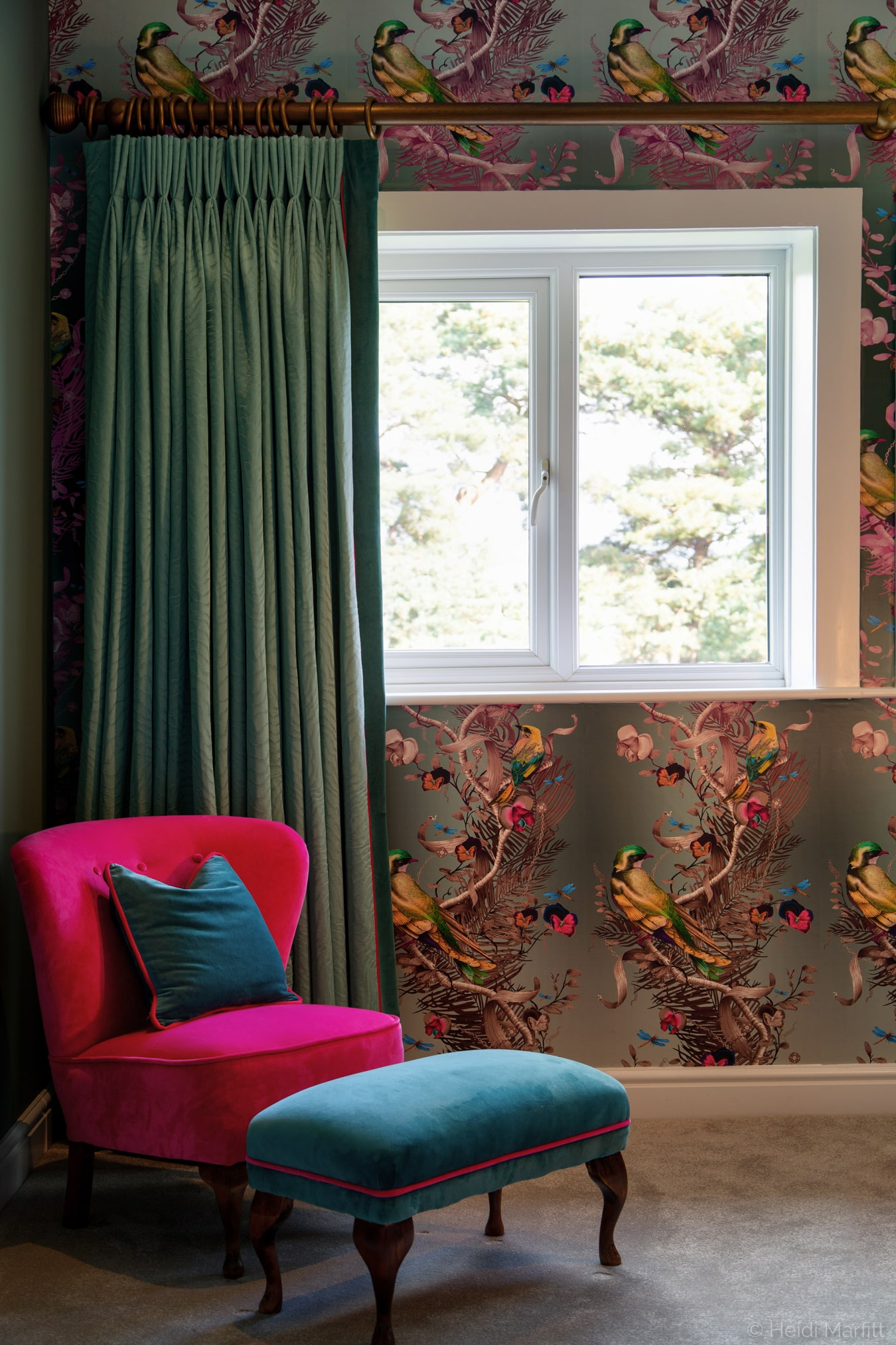 Eau de nil curtains and raspberry pink chair perfectly complement the beautiful Kit Miles Birds in Chains wallpaper