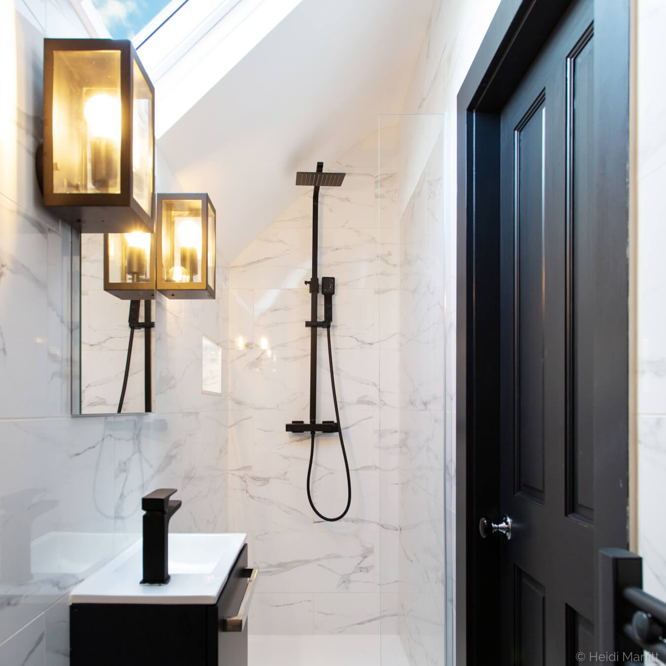 Black taps and shower give an edge to this attic en suite showeroom