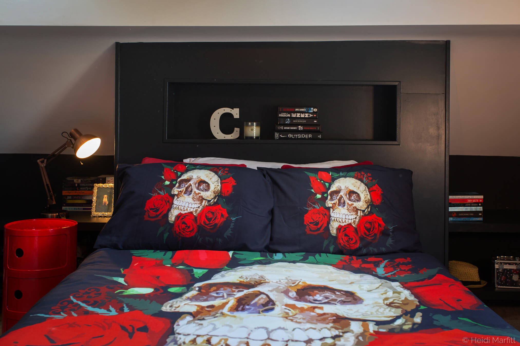 A niche in the headboard is a perfect spot for bedtime reads