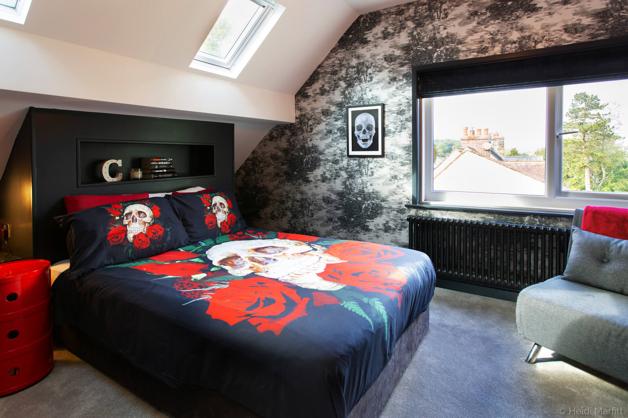 Inky greys and skull patterned accessories turned this attic bedroom into a gothic retreat