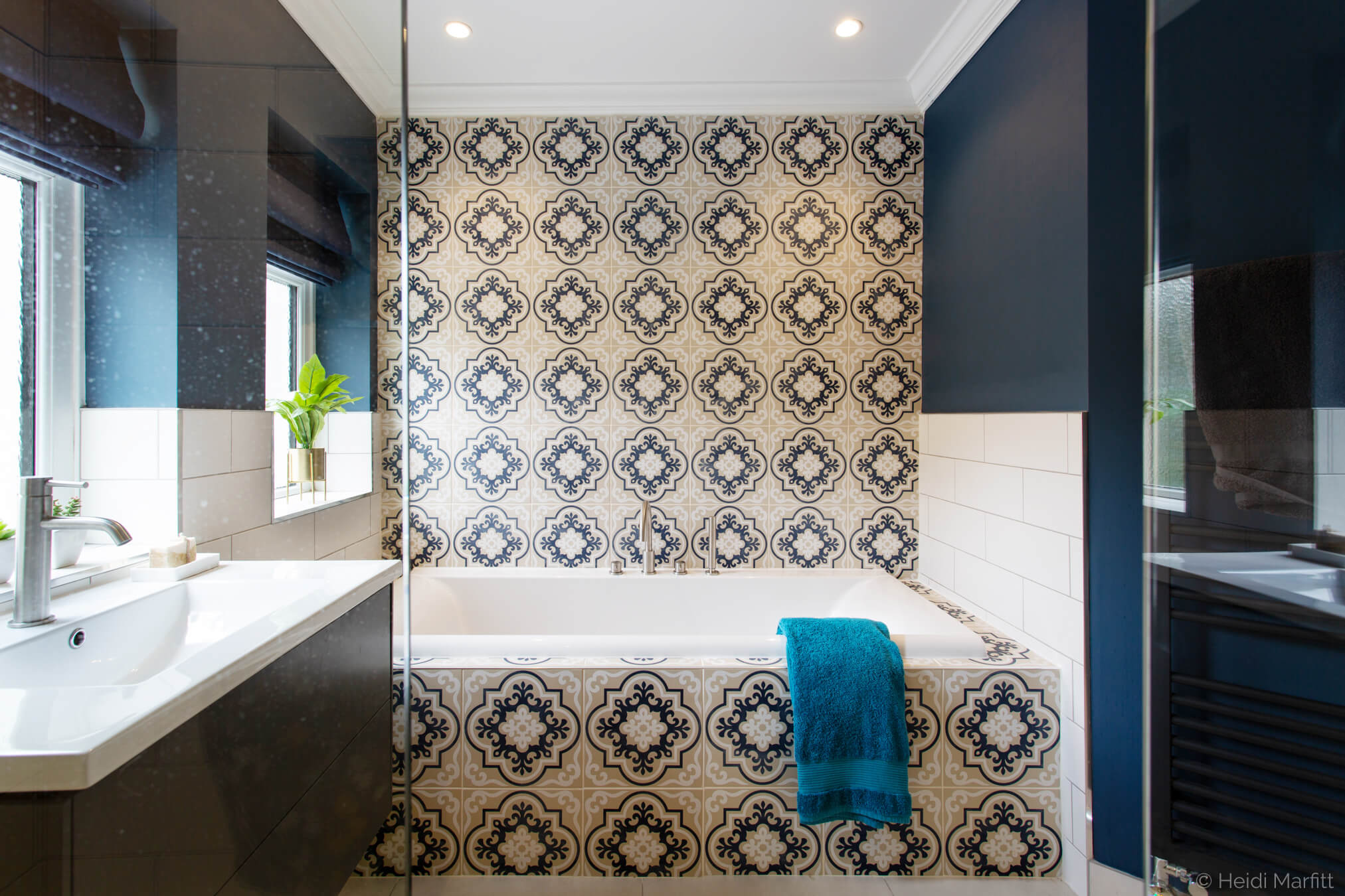 Patterned wall tiles bring personality to this richly coloured family bathroom