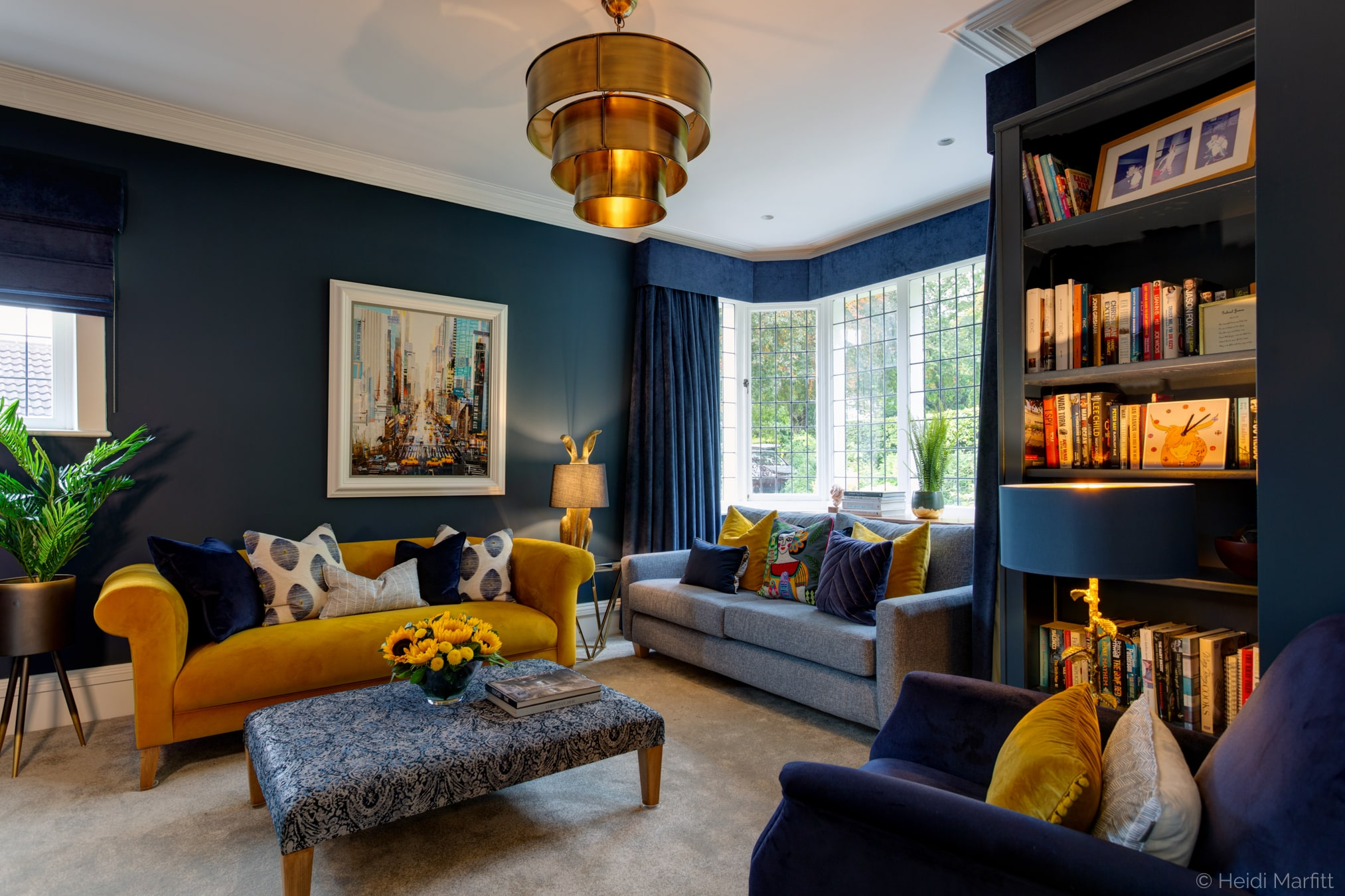 Bespoke bookshelves mean that this cosy sitting room can house the family's treasures