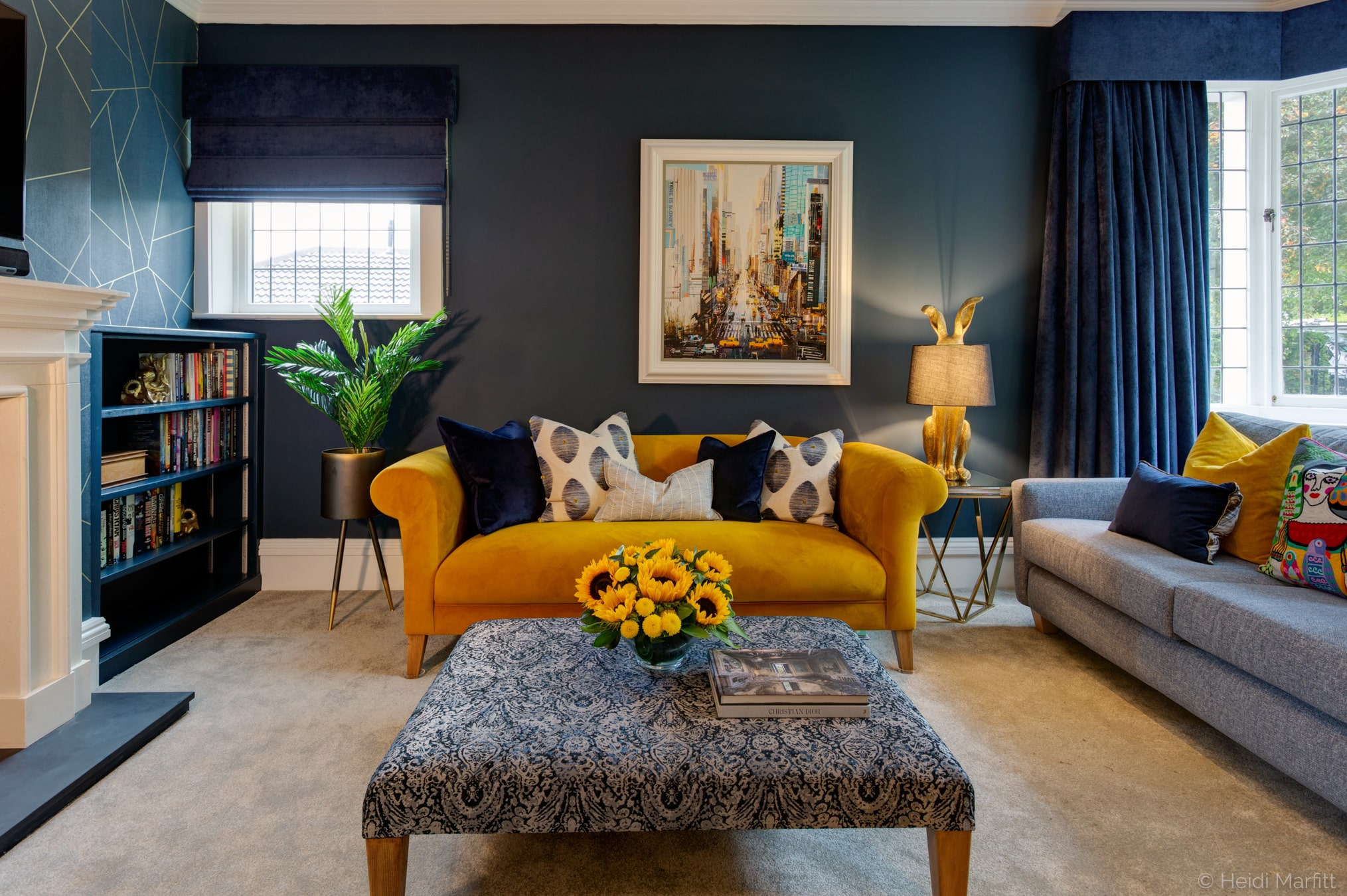 Yellow accents bring this navy sitting room in Yorkshire to life