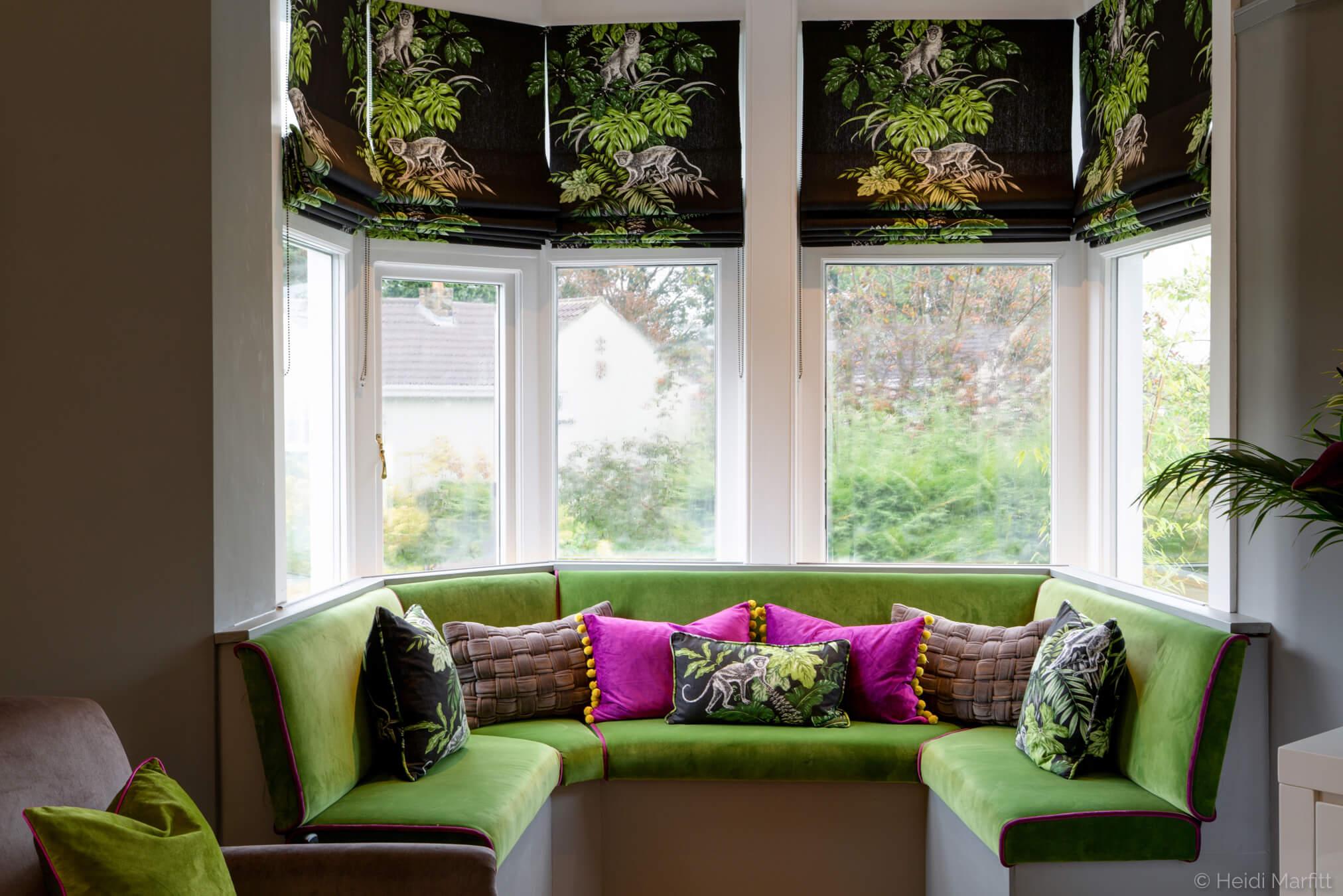 Fresh green velvet makes this window seat a perfect spot