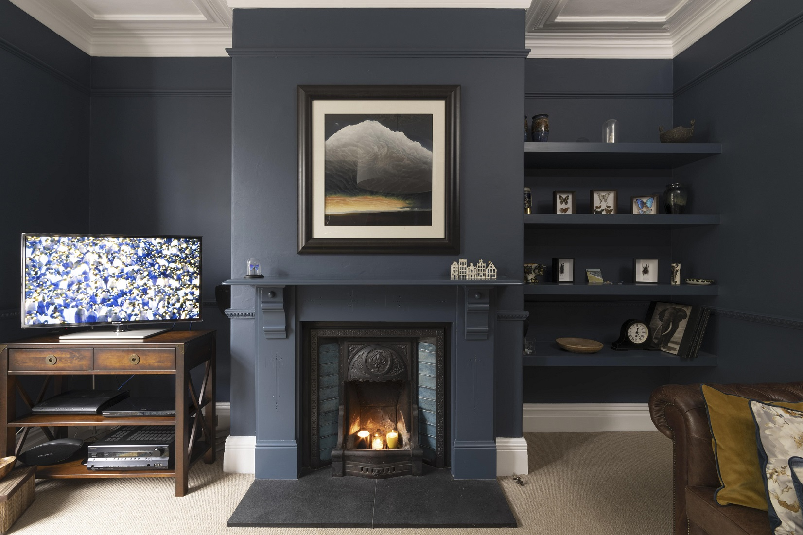 Inky navy walls give warmth to this Victorian family sitting room