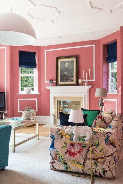 Coral walls complment the beautiful Victorian plasterwork in this characterful sitting room
