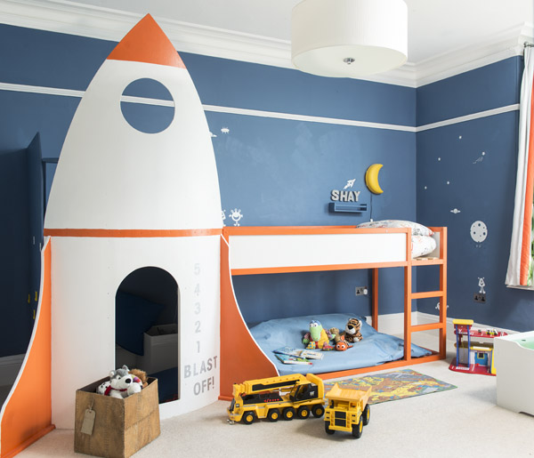 A bespoke rocket bed with a reading nook underneath is a perfect spot for a little boy