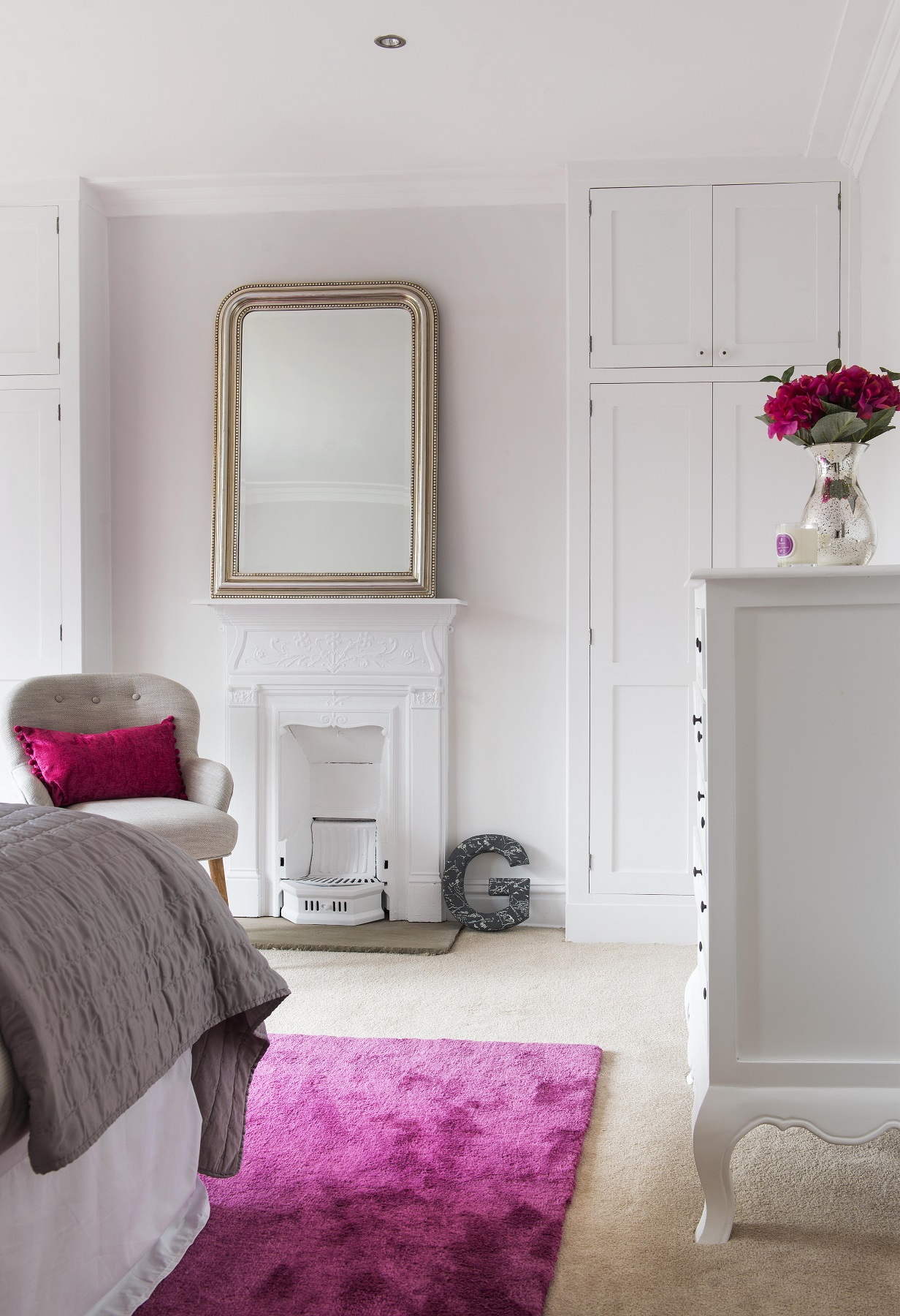Light and airy bedroom with raspberry accents, Yorkshire