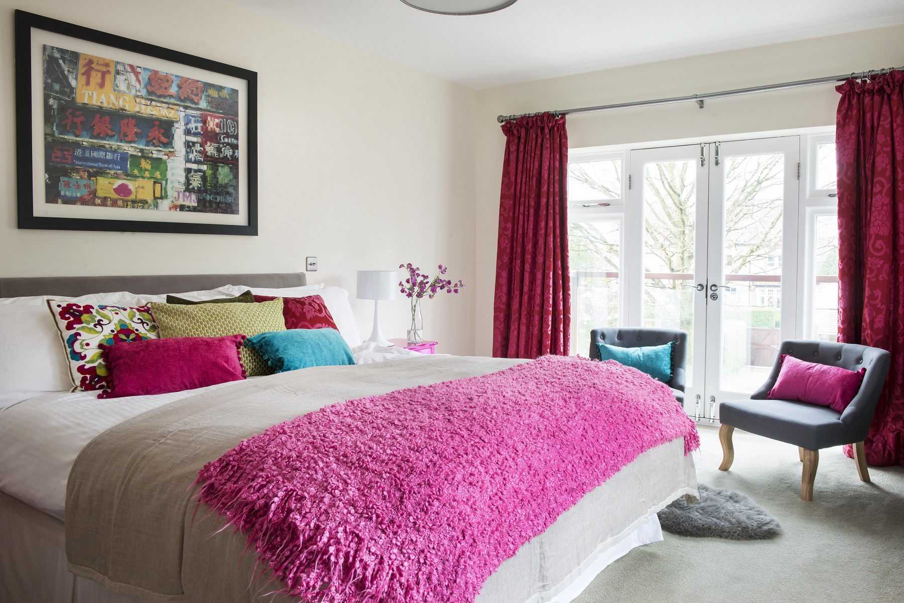 A master bedroom was brought to life with bright colours and original art
