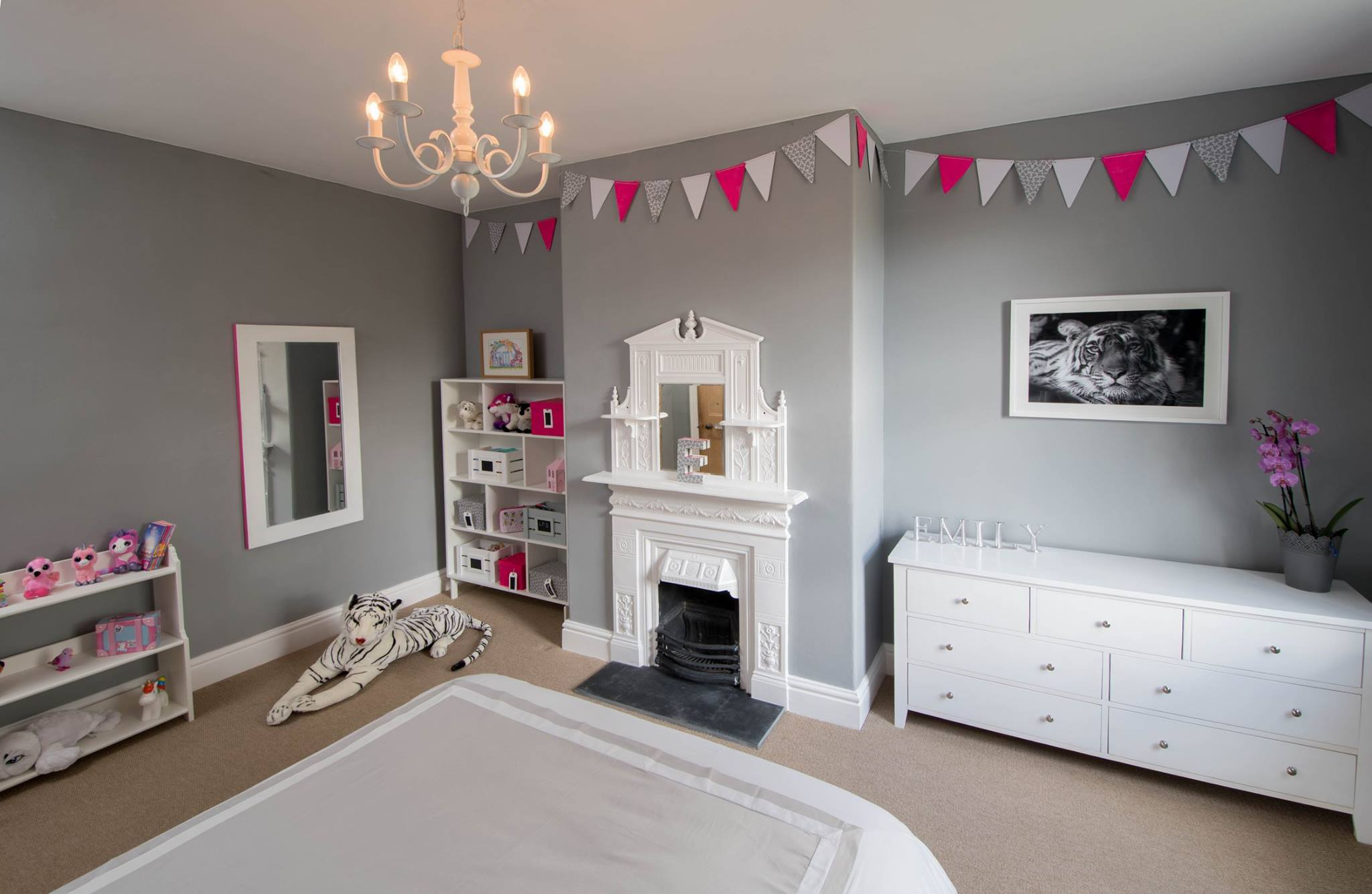 Soothing grey walls are the perfect backdrop for this little girl's bedroom