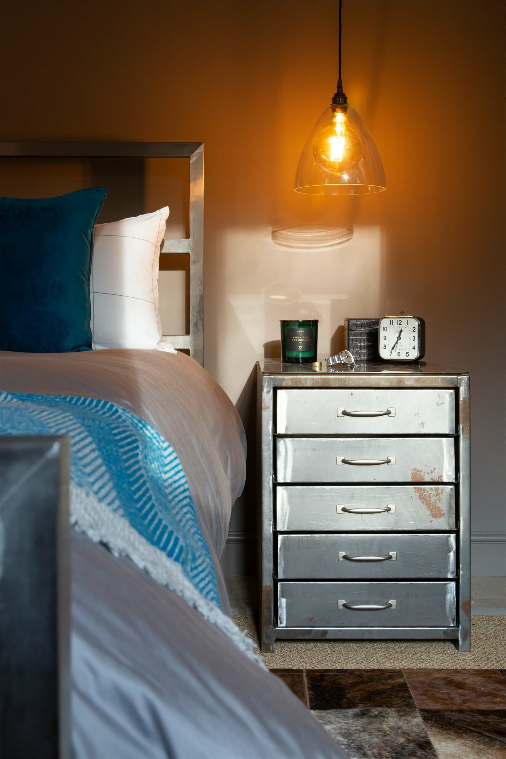 A metal locker provided practical storage in this masculine bedroom