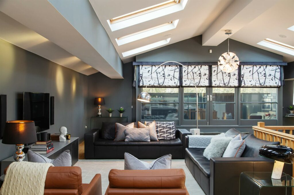 Rich grey walls make this open plan living room inviting and welcoming