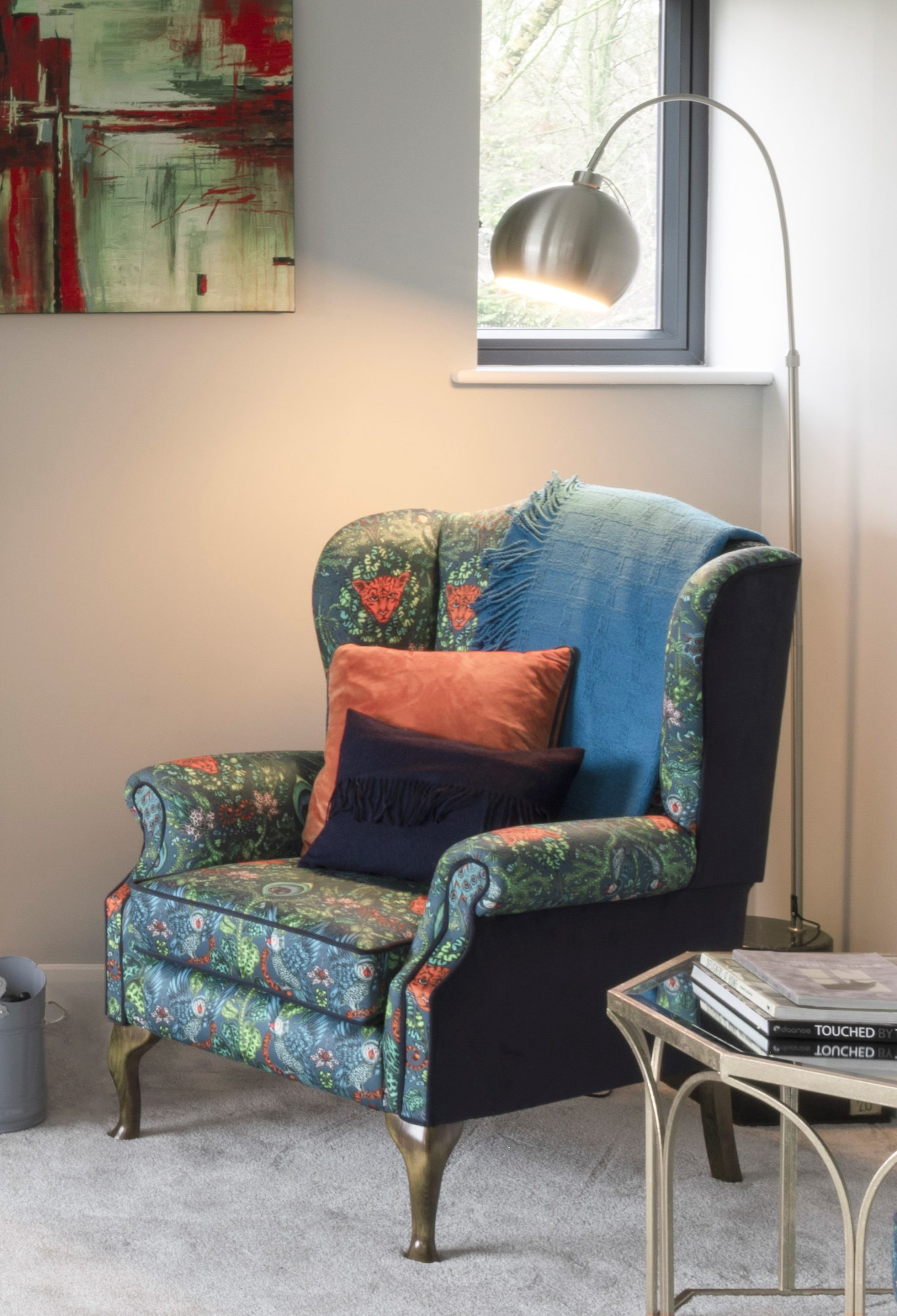 Vibrant pattern and pops of colour make this a cosy corner